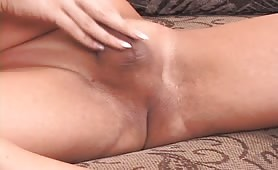 Naked Manly ladyboy On The Couch Rubbing Her rod And Penetrating Her anus With A Special Dildo
