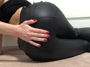 lady in leather pants shows her holes!